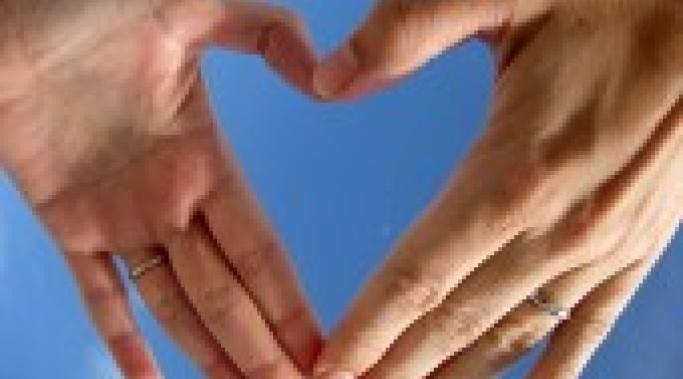 Leon Brocard's photo of two hands forming a heart shape symbolizes love.